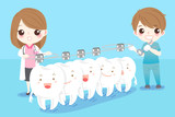 dentist with white tooth - 141693211
