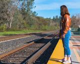 Girl Standing Near Train Rails