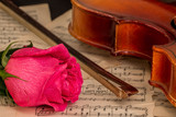 A violin, rose and sheet music