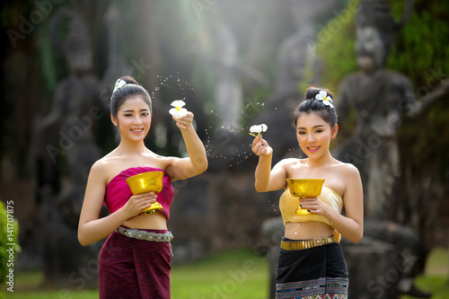 Poster Laos girls splashing water durin tradition festival Laos Vientiane, Songkran fes