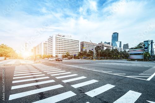 modern office buildings in seoul in cloud sky from road