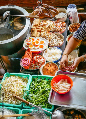 Colored thai food in floating market, food seller in Thailand, typical thai food background - 141724865