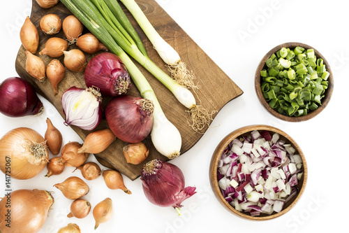 Raw onions on white background