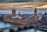 London, England - The famous Big Ben with Houses of Parliament and Westminster Bridge at sunset - 141725635