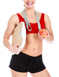 Smiling fit woman with scale and apple, isolated on white background