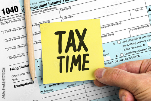 Hand Holding Yellow Paper Note With Words Tax Time