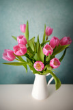 Bouquet of pink tulips in a white vase - 141751671