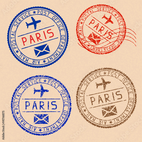 Collection of PARIS postal stamps partially faded on beige paper background