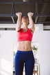 Young woman doing pull-ups