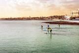 stand up paddle au coucher du soleil