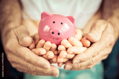 Family holding piggybank in hands