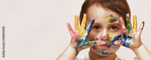 Colorful painted hands in a beautiful little child girl (art, childhood, colour concept)