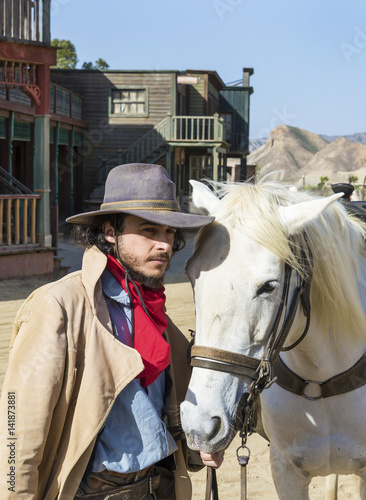 Cowboy with his horse at the Western Town at Mini Hollywood, Tabernas, Almeria Province, Andalusia, Spain