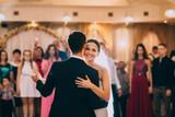 Fototapety Newlywed couple first dance at ballroom