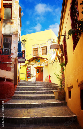 cosy street of Chania old town with stairs, Crete, Greece, retro toned