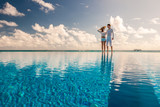 Couple at the poolside - 141937476