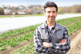 Portrait of an attractive middle aged farmer working on a field - Nature concept