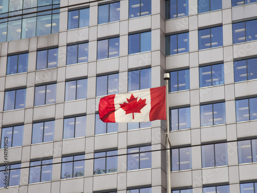 Poster Canadian flag in city centre