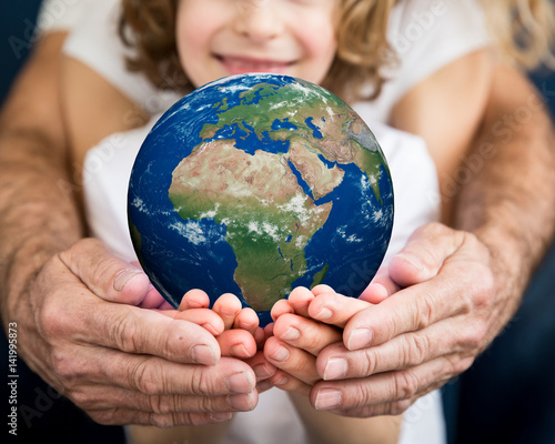 Foto Murales Family holding Earth planet in hands