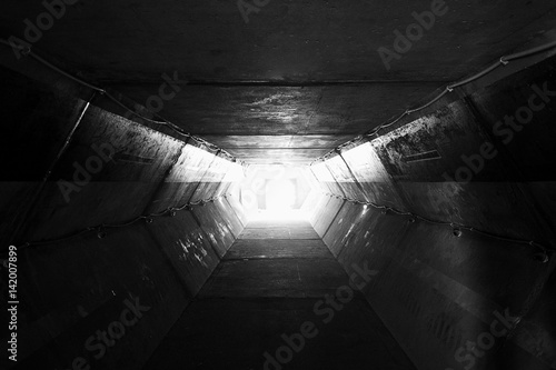 In de dag Tunnel Light at the end of tunnel black and white,square concrete tunnel,Perspective View Through a Dark Tunnel With the Light at The End