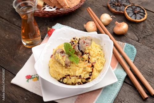 Poster Bowl of saffron rice with sausage and wine
