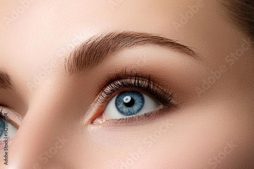 Close up view of beautiful blue female eye - 142010804