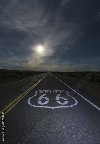 Desert moon over Route 66 sign in eastern San Bernardino County, California