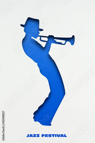Poster Playing jazz / Creative concept photo of trumpet player made of paper on white background