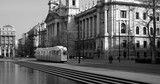 Black and white picture of Ethnography Museum and historical tram in Budapest
