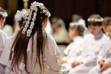 Children going to the first holy communion - 142056013