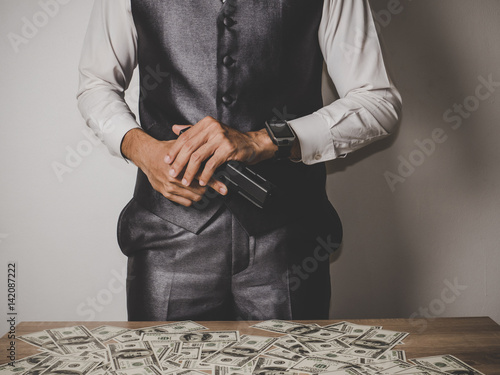 Money and power, Senior gangster with gun, in suit at the table. Poster