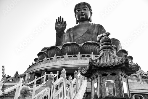 Poster The enormous Tian Tan Buddha (Big Buddha) in black and white color at Po Lin mon