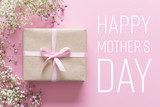 Mother's day card, pink background with white flowers and a present - 142109438