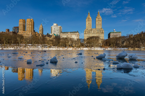 Poster Reflections of Upper West Side buildings in Central Park Reservoir with Ice Chun