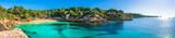 Fototapety Beautiful panorama view of the beach and coast of Cala Gat in Cala Ratjada on Majorca Island, Spain Mediterranean Sea