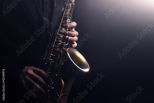 Saxophone player Saxophonist playing jazz music instrument - 142149878