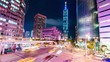 Quadro TAIPEI, TAIWAN - 01 MAY 2016: (Timelapse View) By the corner of busy Taipei street after working hours with Taipei 101 at back, 01 MAY 2016 in Taipei, Taiwan.