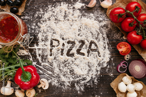 Cooking Pizza. Pizza ingerdients on the wooden table, top view Poster