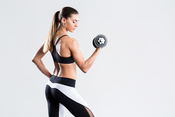 Woman with dumbbell fit slim abs body. © BestForYou