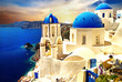 Amazing Santorini over sunrise. View of Oia village with famous blue churches. Greece