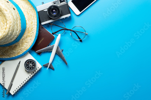 Foto Murales Travel accessories with copy space on blue background