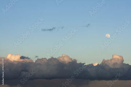 Moon and clouds Poster