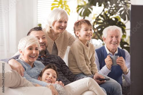 Happy big family watching tv