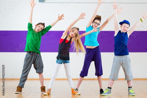 Kids train Zumba fitness in dancing school Poster