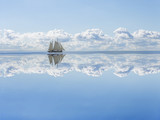 Sailboat sails into the calm in the sea bay. - 142261038