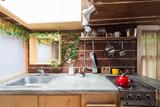 Rustic kitchen in a bright cabin. Interior design. - 142262433