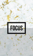 Focus motivational quote on modern marble texture.