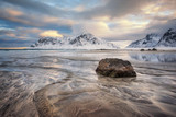 Norway. Lofoten islands. Scagsanden beach. Landscape with different colors of sand in the foreground and Norway mountains on the background