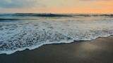 Beautiful sea waves. Black sand beach at sunset on Bali island coast slow motion - 142329428