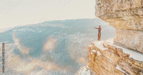Explorer man standing on cliff Eagle shelf